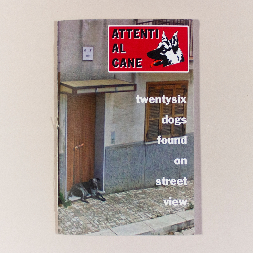 "Attenti al Cane, Front cover. Cover image is a photo of a dog laying in a doorway beneath the text ""Attenti Al Cane twentysix dogs found on street view"""