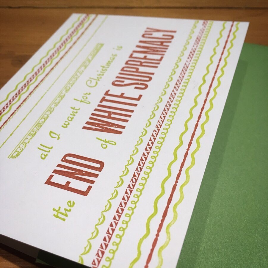 Letterpress-printed Christmas card with festive red and green borders. Text reads: All I Want for Christmas is the End of White Supremacy.