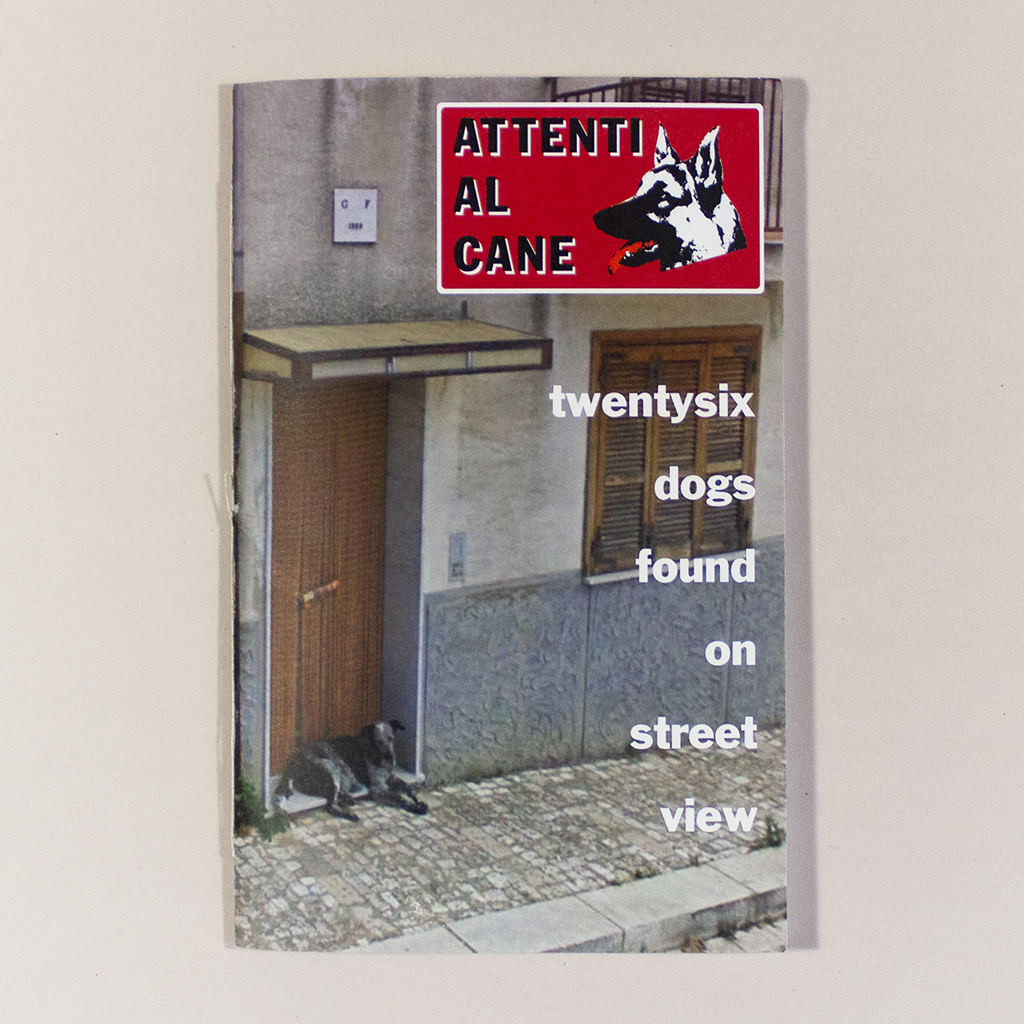 """Attenti al Cane, Front cover. Cover image is a photo of a dog laying in a doorway beneath the text """"Attenti Al Cane twentysix dogs found on street view"""""""