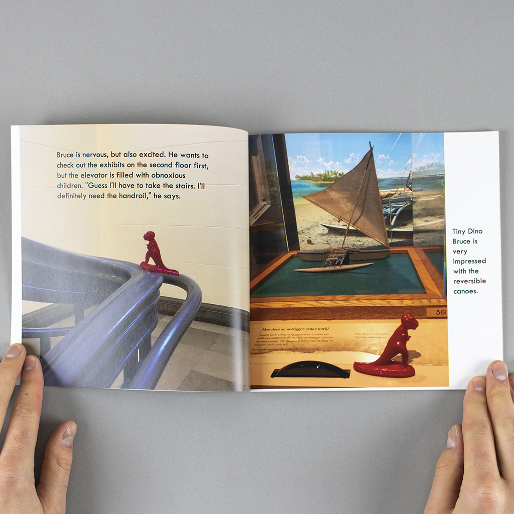 Inside spread; toy dinosaur climbs the banister of a staircase and views an interactive diorama.