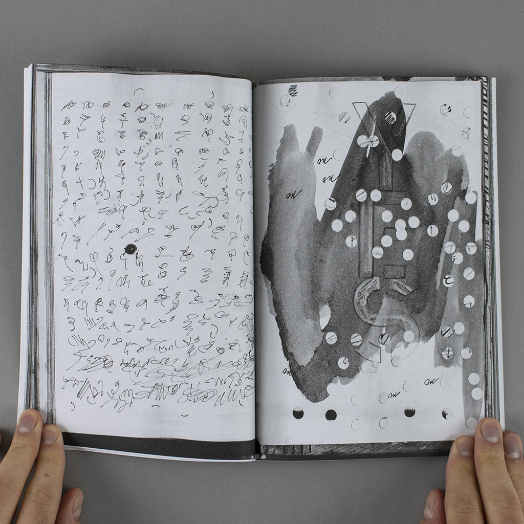 False Fiction Fractured Fact Altered inside spread with asemic writing on the verso, and stenciled text and hole punched paper on the recto