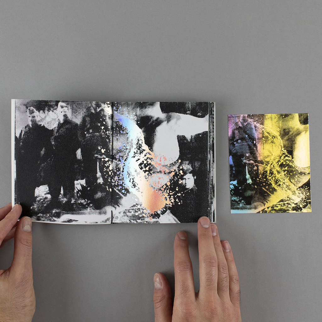 Fragmented Memory inside spread with an unbound screen print on iridescent foil. A splash of champagne covers a tumbling man while a group of uniformed soldiers look on.