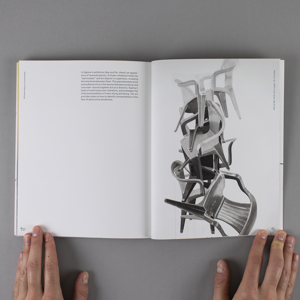 """""""Object Objects"""" inside spread pages 90-91: text on the verso and a black and white photo of a tangled stack of plastic chairs on the recto"""