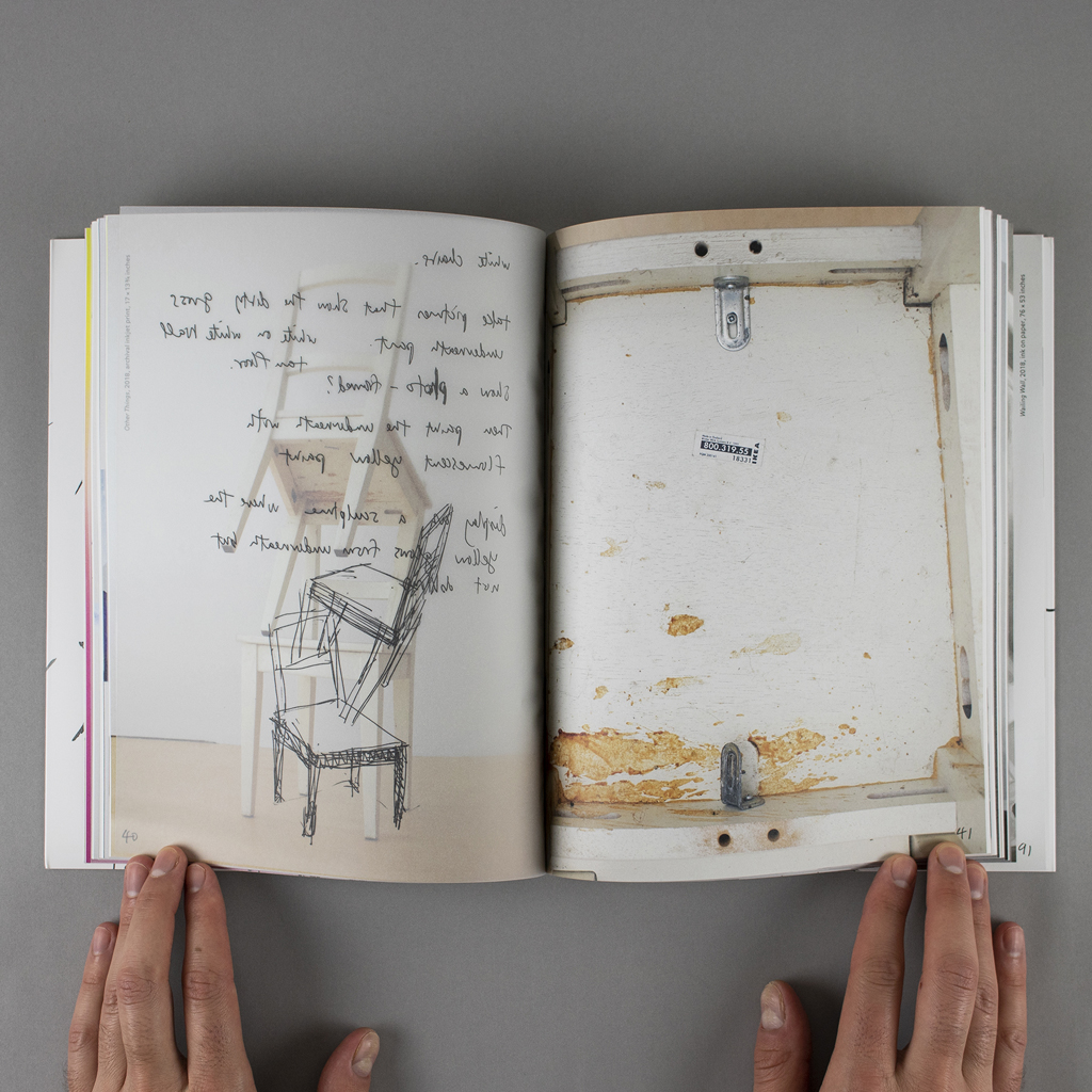 """""""Object Objects"""" inside spread pages 40-41. A photo of balanced wooden chairs on the verso, with a vellum overlay of notes and a sketch for the same piece. On the recto is a detail shot of the worn underside of one of the chairs, with a manufacturer's label"""