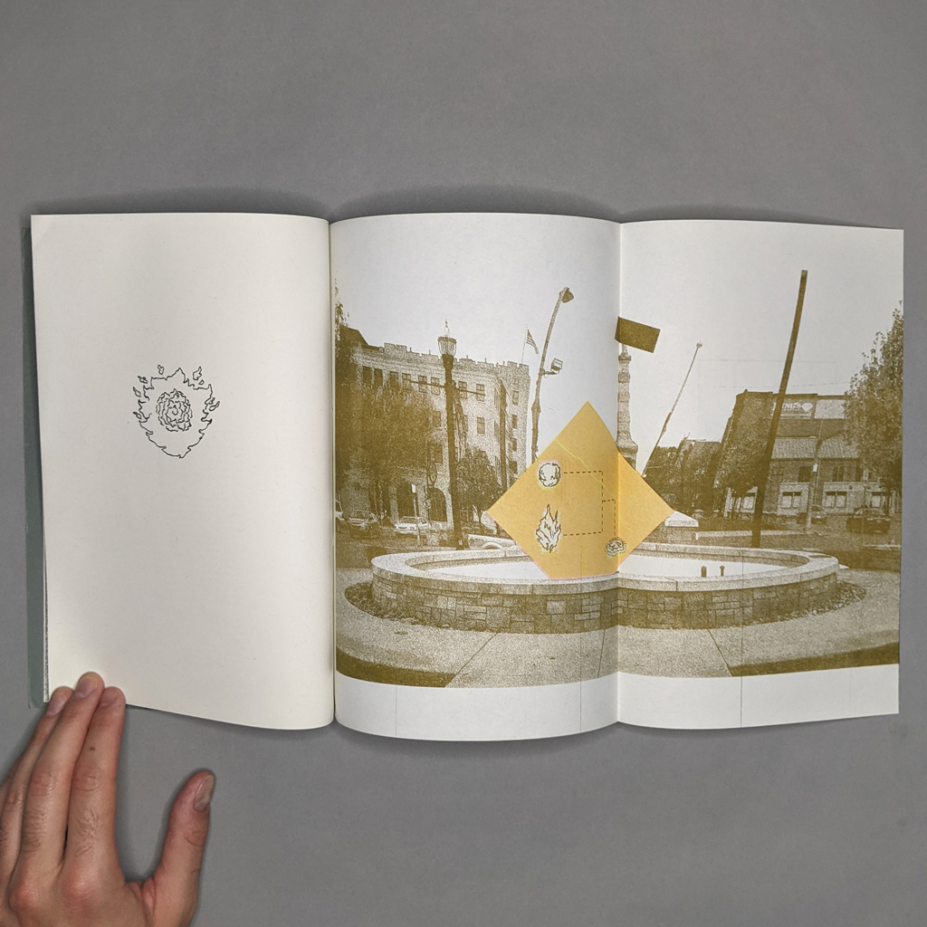 Terra Nullius three-page spread, with a fireball on the left and a distorted traffic circle on the right.
